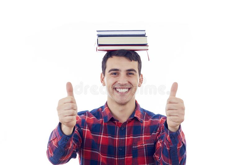 Trying to Learn Too Much. Stressed young man student looking to camera holding a book with steam coming out up of head isolated on gray background. Busy stock photos