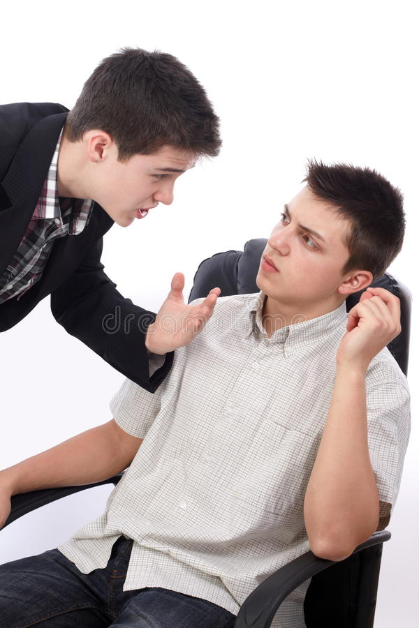Trying to persuade. Young businessman explaining something to his boss royalty free stock photography