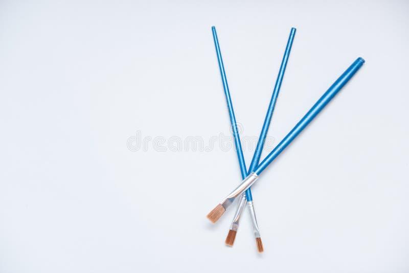 Trzy błękitnego muśnięcia dla malować fotografia stock