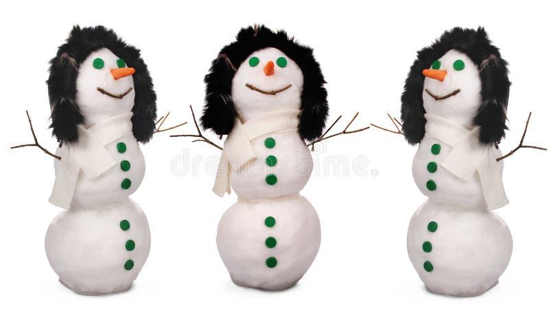 Trzy bielu bałwanu whith zieleni marchewki i guziki zdjęcia royalty free