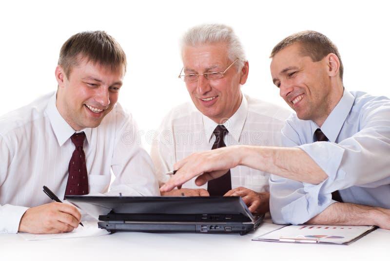 Trzy biznesmenów target459_1_ obraz stock