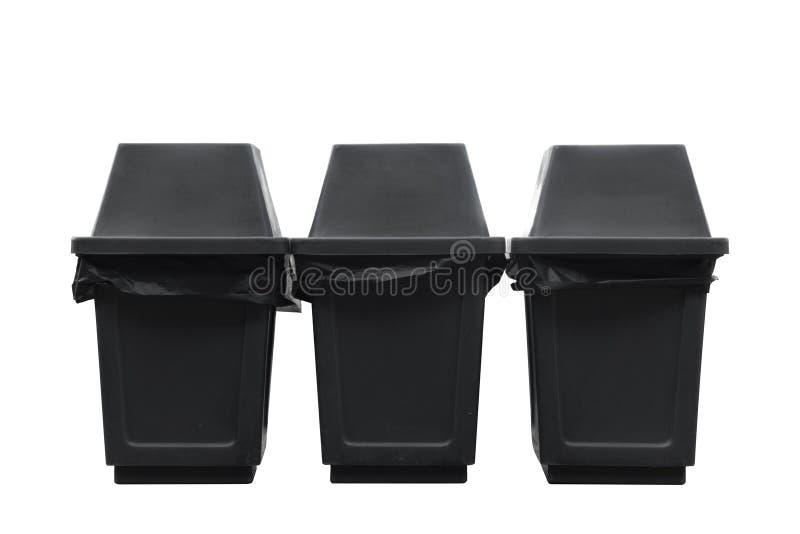 Trzy czarny grat, jałowy kosz dalej odizolowywają fotografia stock