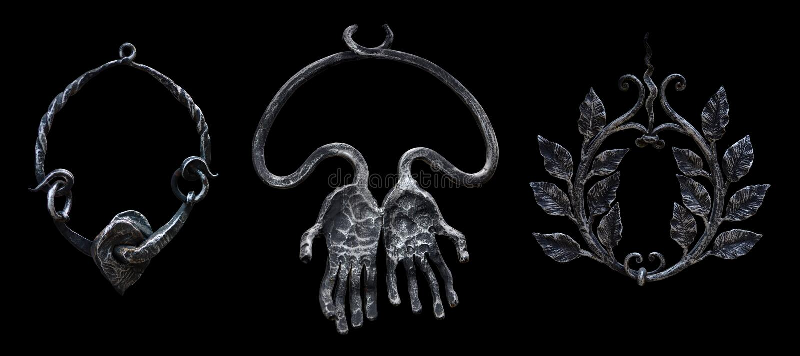 Trzy dekoracyjnego forged metali breloczków pierścionku odizolowywającego na czerni zdjęcie royalty free
