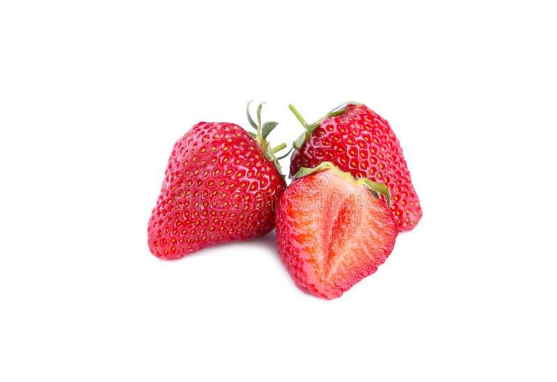 Trzy dojrzałego trawberries odizolowywającego na białym tle fotografia stock