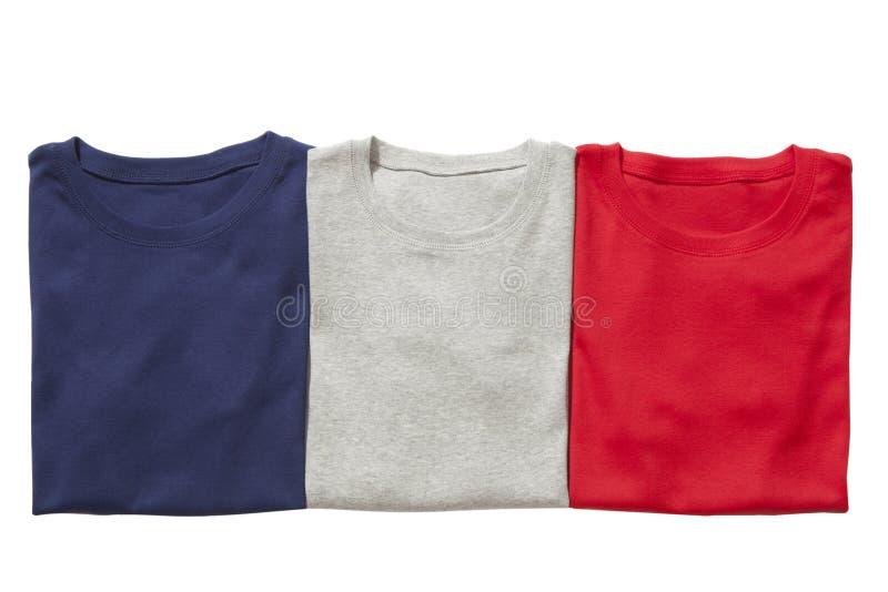 Trzy fałdowej koszulki odizolowywającej obrazy stock