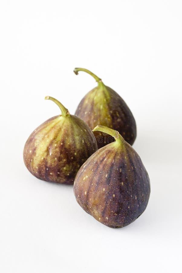 Trzy figi owoc na białym tle zdjęcie royalty free