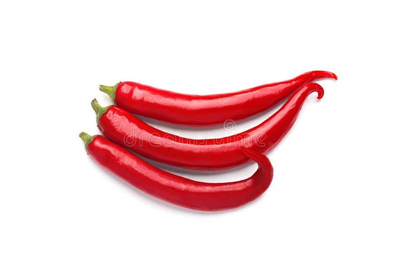Trzy gorących chili pieprzu odizolowywającego na biały tle obraz stock