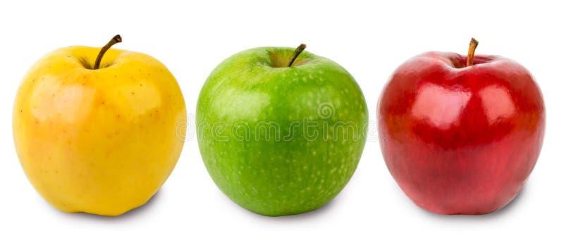 Trzy jabłka zielenieją, kolor żółty i czerwień na bielu, odizolowywającym zdjęcia royalty free
