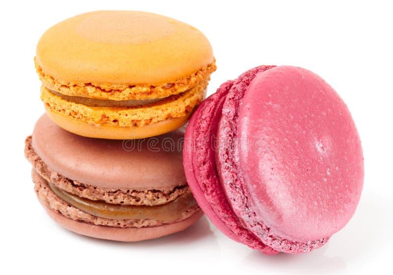 Trzy kolorowego macarons na białym tle zdjęcie stock