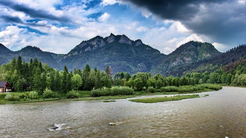 Trzy Korony peak over the river of Dunajec in Sromowce Niżne in Poland. Trzy Korony, Three Crowns, Tri koruny, the summit of the Three Crowns Massif, an stock photography