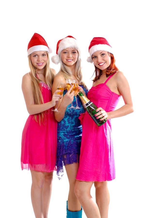 Trzy młodej dziewczyny odświętność Bożymi Narodzeniami są zdjęcie stock