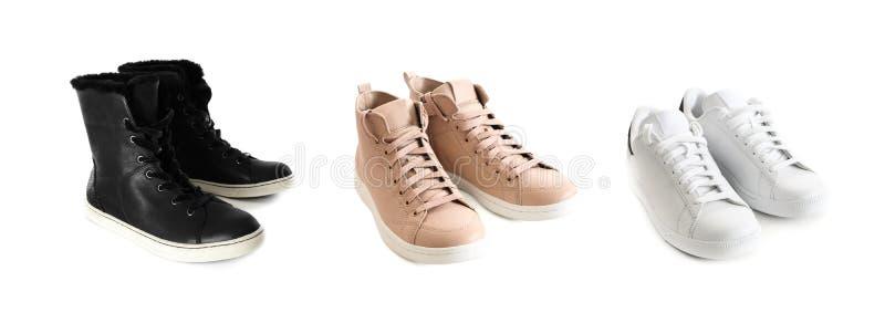 Trzy pary kobiet sneakers odizolowywający na białym tle Fas fotografia stock