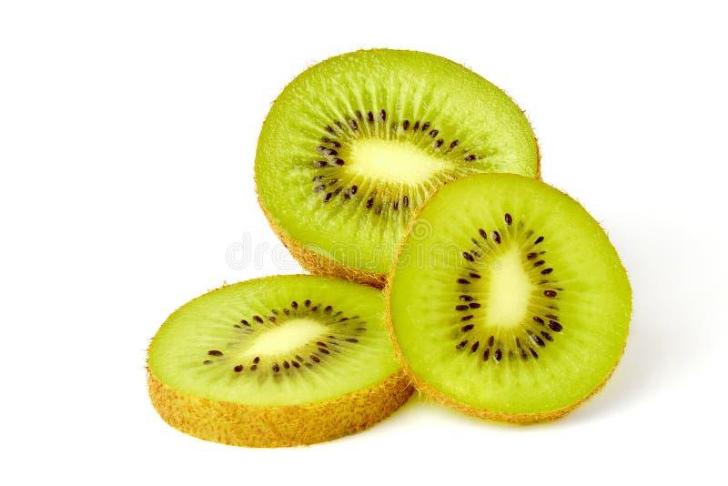 Trzy Pokrojonej kiwi owoc Na Białym tle obrazy royalty free