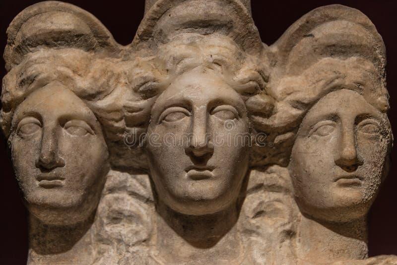 Trzy przewodzili azjata antyczną statuę piękne kobiety, Godd obraz royalty free