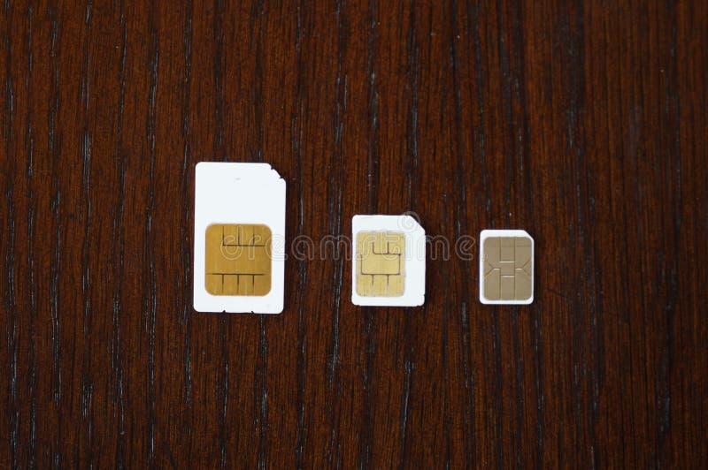 Trzy rodzaju sim karty na biurku zdjęcie royalty free