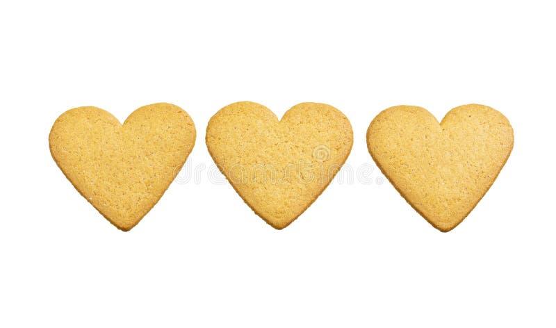 Trzy serca imbirowi ciast ciastka odizolowywający na białym tle Słodki deserowy piękny ornament zdjęcia stock
