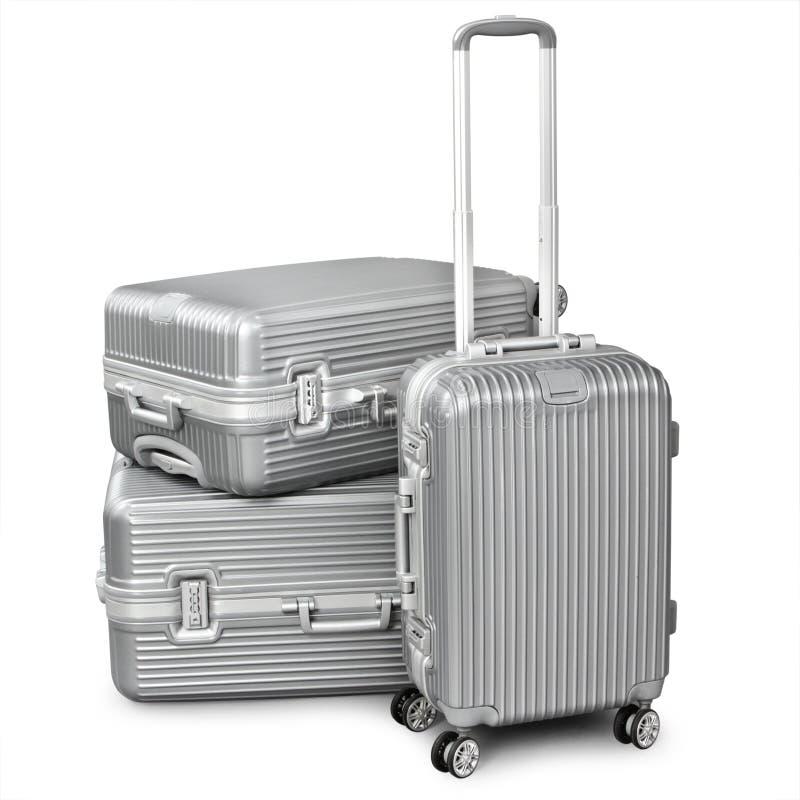 Trzy srebna walizka fotografia royalty free