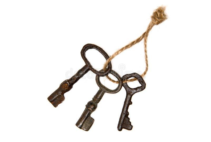 Trzy starego klucza od drzwi wiązali z arkaną zdjęcia stock