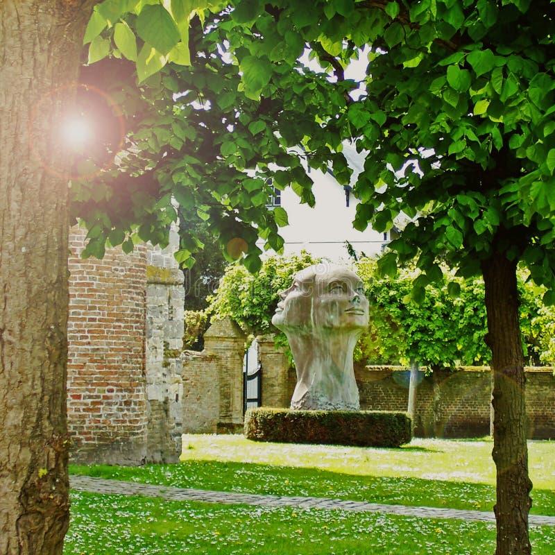 Trzy stawiali czoło statuę Belgia obraz royalty free