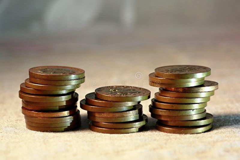 Trzy stosy monet metalowych obrazy stock