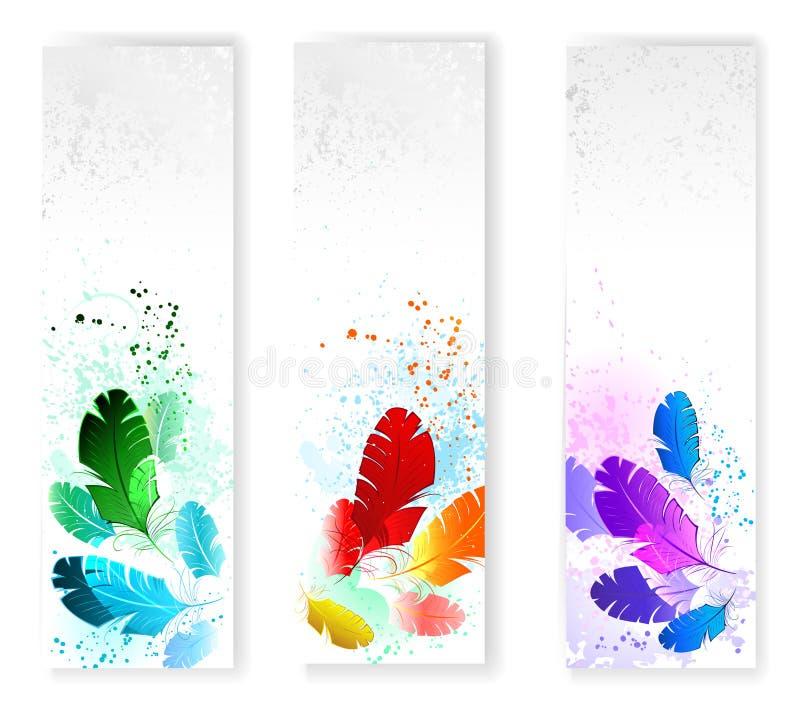 Trzy sztandaru z barwionymi piórkami