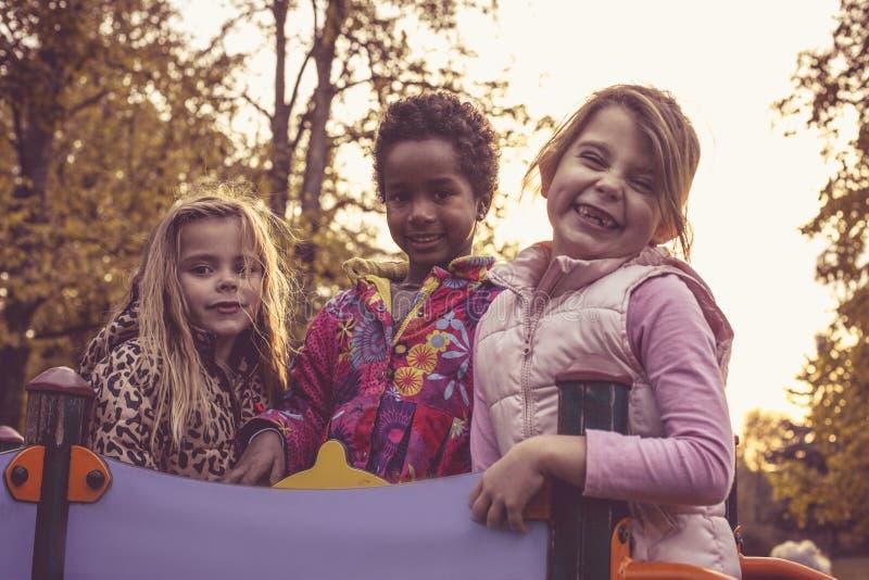 Trzy uśmiechniętej małej dziewczynki zdjęcie royalty free