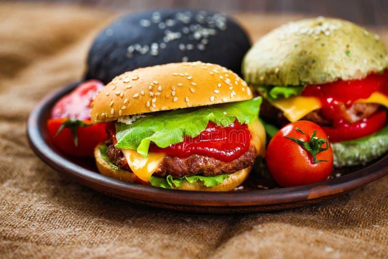 Trzy wyśmienicie hamburgeru fotografia stock