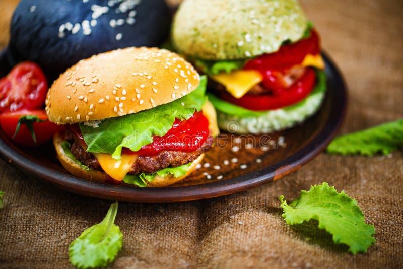 Trzy wyśmienicie hamburgeru obraz stock