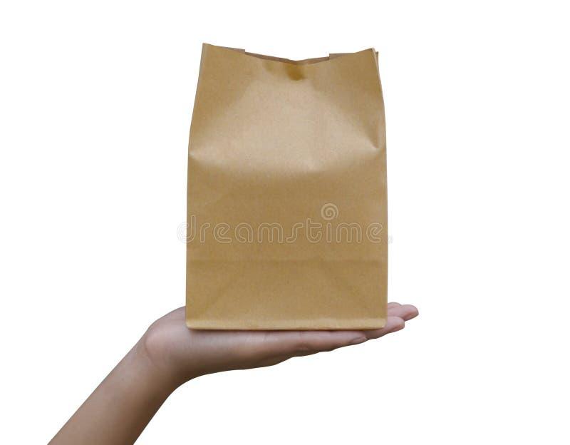 Trzymać brąz papierową torbę w ręce fotografia stock