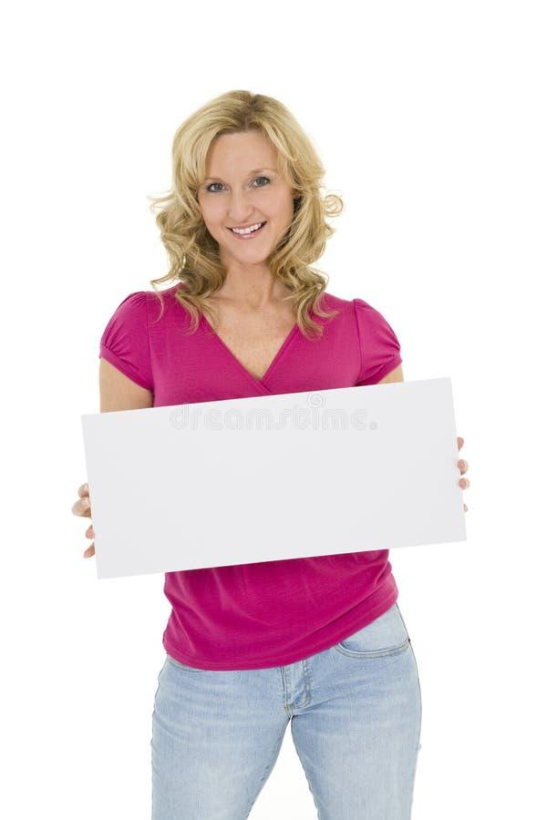 trzymać szyldowej kobiety fotografia stock