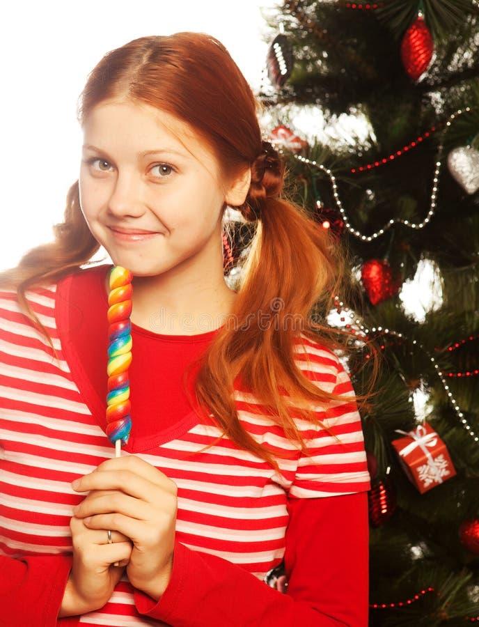 trzymający odosobnionego lolly wystrzału ładnej białej kobiety młody Święta moje portfolio drzewna wersja nosicieli obraz stock