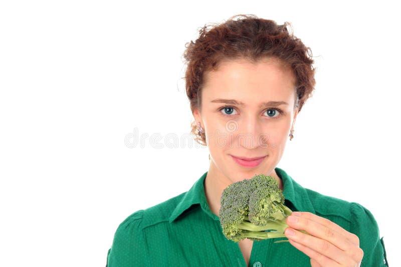 trzymaj kobietę brokuły młoda fotografia royalty free