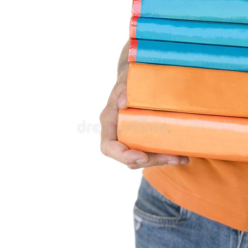 trzymaj ręce książki śliwek ścieżki w stertę zdjęcia stock