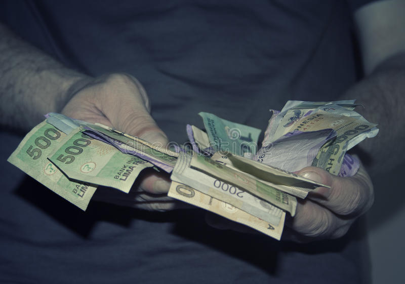 trzymaj ręce pieniądze zdjęcie royalty free