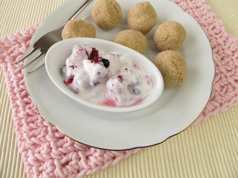 Tsampa balls with fruit yogurt stock images