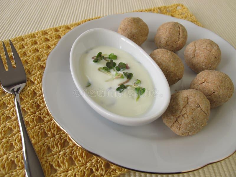 Tsampa balls with yogurt and radish sprouts stock photo