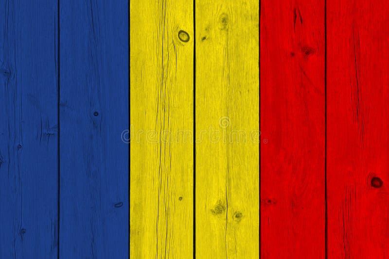 Tschad-Flagge gemalt auf alter hölzerner Planke lizenzfreie stockfotos