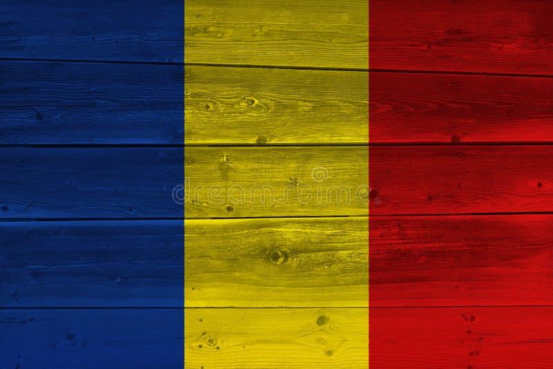 Tschad-Flagge gemalt auf alter hölzerner Planke stockbilder