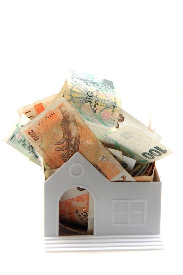 Tschechisches Geld und Haus stockbild