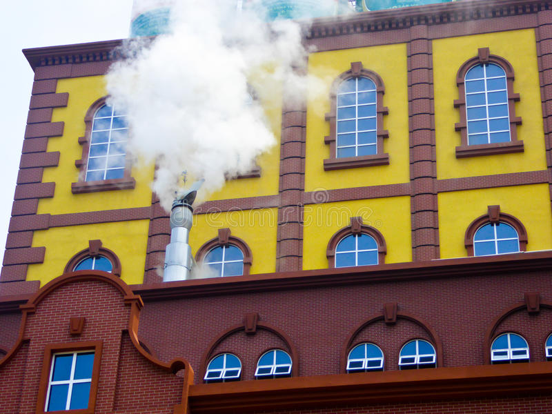 Tsingtao beer Museum. Steam coming out of the chimney inside Qingdao Beer Museum buildings in Shandong province China royalty free stock image