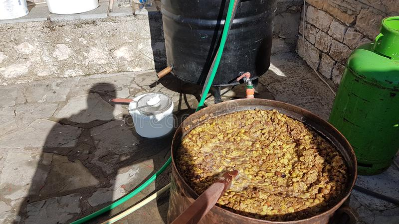 Tsipouro distilation production in Ioannina Greece. Grapes stock photography