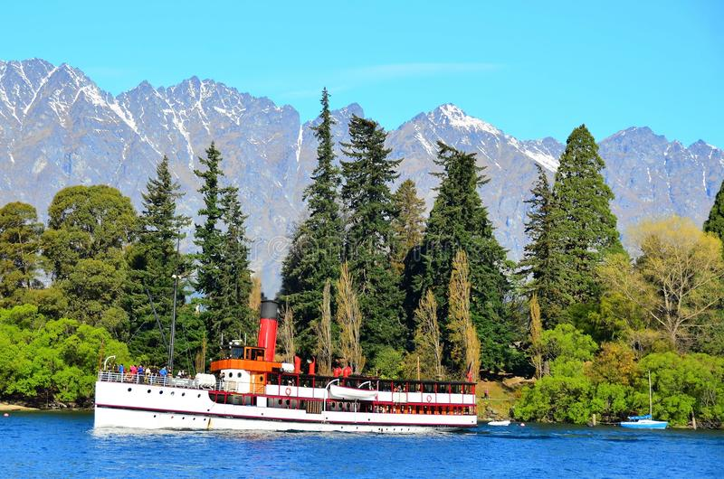 Steamship, Queenstown, New Zealand. TSS Earnslaw 1912 Edwardian vintage twin steamer. Last remaining commercial passenger carrying coal-fired steamship in royalty free stock photo