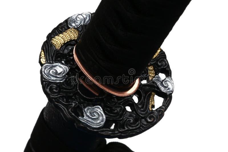Tsuba: handvakt av det japanska svärdet royaltyfri fotografi