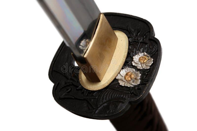 Tsuba: handvakt av det japanska svärdet arkivfoto