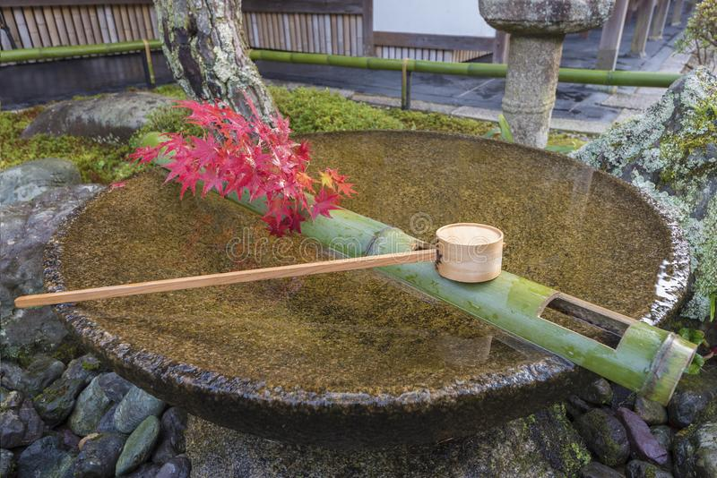 Tsukubai Water Fountain in Japanese Garden royalty free stock image