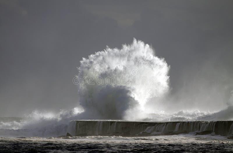 Tsunami. Big storm wave against harbor of Vila do Conde, north of Portugal stock photos