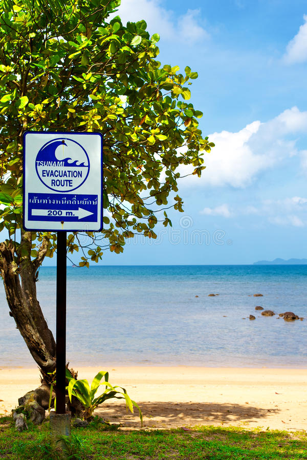 Tsunami Evacuation Route Sign. On a beach, Thailand royalty free stock photos