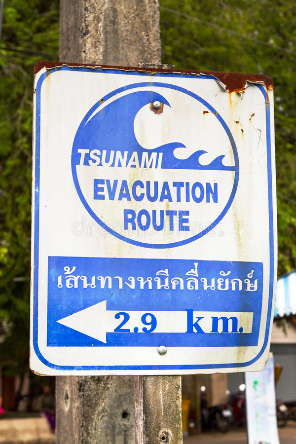 Tsunami Evacuation Route Sign. In Thailand royalty free stock image