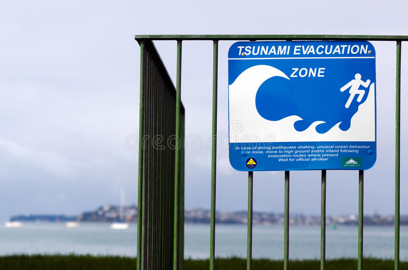 Tsunami evacuation route sign. AUCKLAND,NZ - MAY 30:Tsunami evacuation route sign on May 30 2013.A seabed earthquake along numerous stretches of the NZ coast can royalty free stock photos
