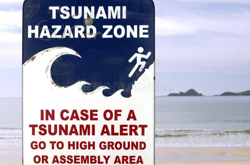 Tsunami evacuation route sign. In a coastal area royalty free stock photo
